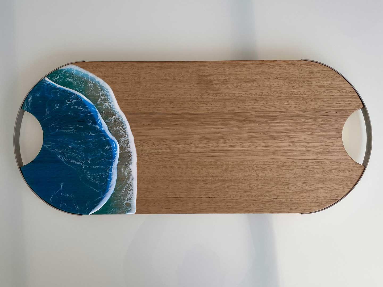 Blue resin art waves on Tasmanian oak serving board