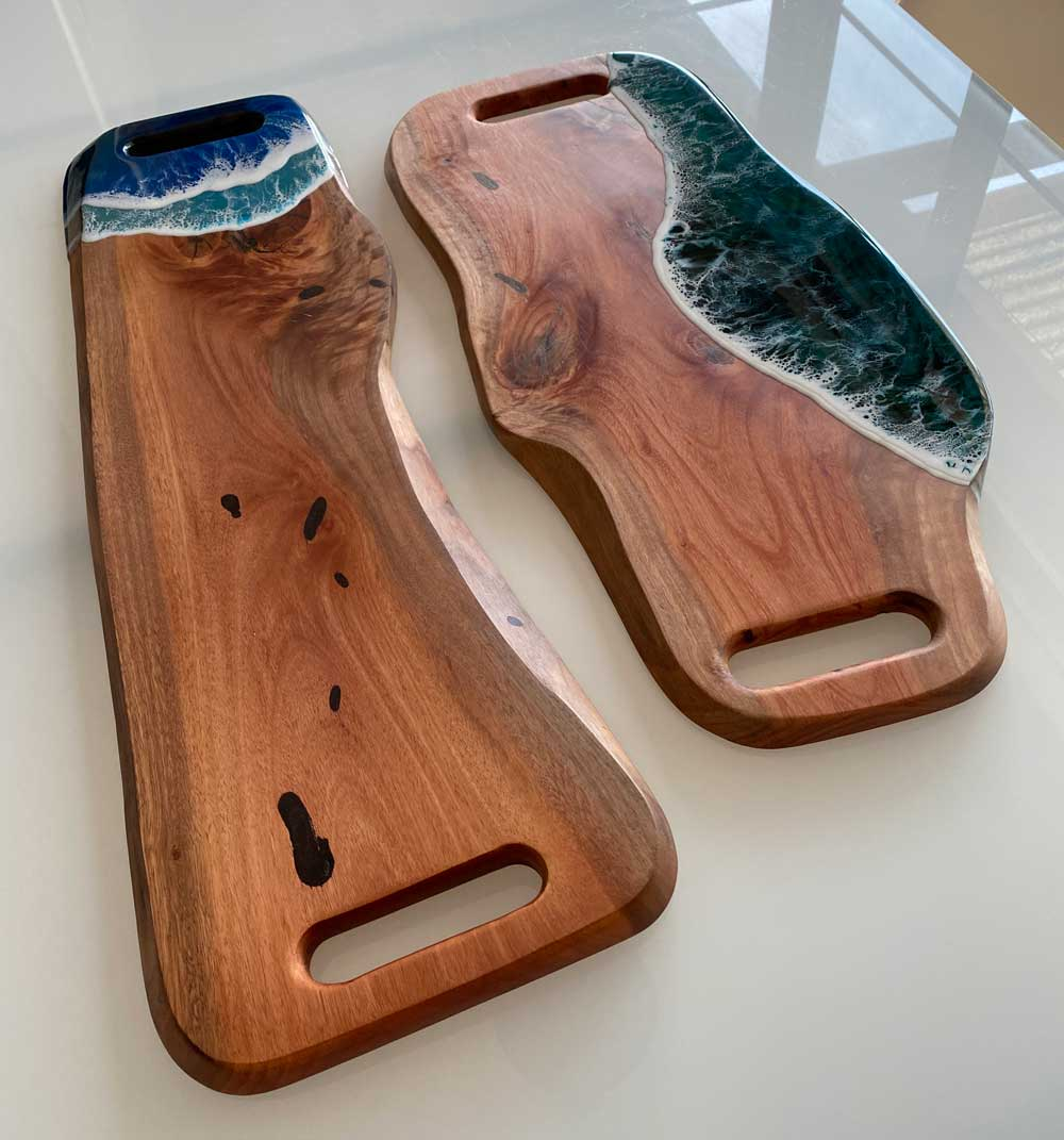 Mahogany charcuterie board with resin ocean wave