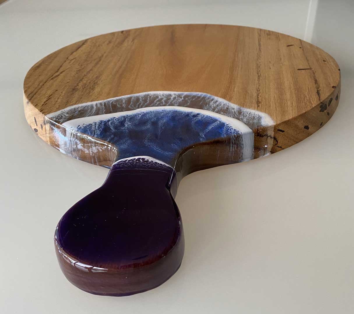 yellow stringy bark round cheese board with resin wave